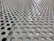 Foro d'argento del metallo con luce Fotografia Stock Libera da Diritti