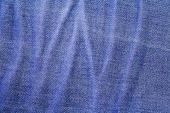 Foro di bottone delle blue jeans del denim Immagine Stock Libera da Diritti
