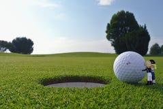 Foro e palla di golf Immagine Stock