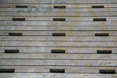 Foro quadrato su legno Immagine Stock