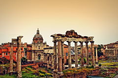 Foro Romano Rome Italy. The excavated remains of Roman ruins in Roman Forum-Foro di Cesare, Temple of Saturn  and Septimius Severus Arch Stock Images