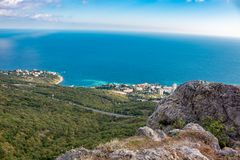 Foros, Crimea - September 2014: View from the mountain Kyzyl-Kaya to Foros settlement. Southern coast of Crimea royalty free stock image