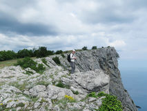 Foros, Russia - May 28, 2016: backpacker on top of AI-Petry plateau, Crimea Stock Photos