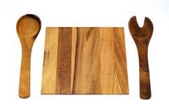 Forquilha da colher e placa de corte de madeira Imagem de Stock