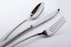 Forquilha da faca da colher em um ângulo Imagem de Stock