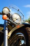 Forquilha dianteira do close up do detalhe da motocicleta e farol e roda Imagens de Stock