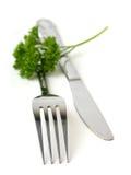 Forquilha e faca e enigma Fotos de Stock Royalty Free