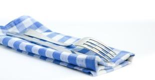 Forquilha e faca em um guardanapo checkered Foto de Stock