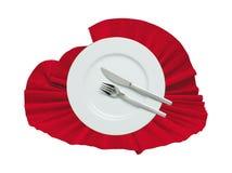 Forquilha, faca e placa branca em um pano vermelho Imagem de Stock Royalty Free