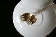 Forquilhas de prata alemãs da sobremesa na placa Fotografia de Stock Royalty Free