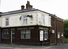 "Forresters Arms. Manchester, England – 18th August 2015. ""Forresters  Arms"", a well known local pub in North Manchester, which now closed and boarded up Royalty Free Stock Image"