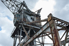 Forsaken crane on port Stock Images