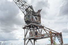 Forsaken crane on port Stock Image