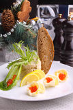 Forshmak decorated with salad , lemon and red caviar Stock Photo