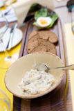 Forshmak of herring in the restaurant. Forshmak of herring with green apples, red onion, with rye bread and egg on wooden plate. Focus on spoon Stock Photo