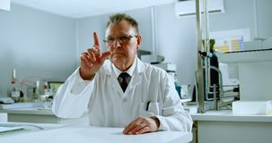 Forskare som använder osedd ny teknik i laboratoriumet 4k lager videofilmer