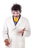 Forskare som jonglerar med en apelsin Royaltyfri Bild