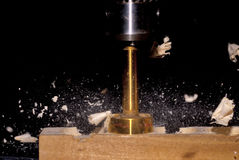 Forstner Bit drilling through a piece of wood Stock Photos