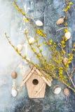 Forsythia spring flowers Easter eggs birdhouse decoration Stock Photo