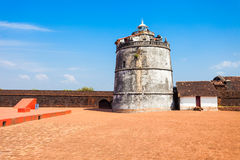 Fort Aguada in Goa. Fort Aguada and its lighthouse is a portuguese fort standing on Sinquerim Beach in Goa, India stock images
