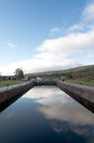 Fort Augustus Locks with reflection of the sky. Fort Augustus Locks in Scotland Stock Image