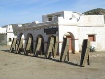 Fort Bravo Undertaker. FORT BRAVO SPAIN - JANUARY 23RD. Wooden coffins outside undertaker in Fort Bravo Film Set Tabernas Desert. Fort Bravo, Spain January 23rd Royalty Free Stock Images