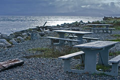 Fort Casey Keystone Harbor. Picnic tables line the beach of the Campground overlooking Keystone Harbor at Fort Casey on Whidbey Island Washington State stock photography