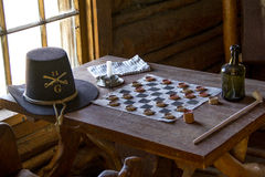 Fort Caspar Memorabilia circa 1865. Checkers game on desk at Fort Caspar, Wyoming.  Also known as Platte Bridge Station Royalty Free Stock Image