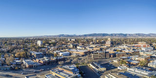 Fort Collins cityscape aerial panorama. Fort Collins downtown aerial panorama, fall scenery in Colorado with Front Range of Rocky Mountains in background Royalty Free Stock Images