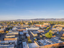 Fort Collins downtown aerial view. Aerial view of Fort Collins downtown in sunrise light, shot from a low flying drone Royalty Free Stock Photography