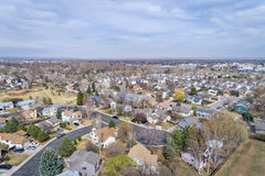 Fort Collins in early spring from air. Aerial view of a typical residential area along Front Range in Colorado - Fort Collins in early spring Royalty Free Stock Photos