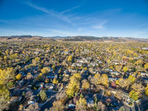 Fort Collins in fall colors from air. Aerial view of Fort Collins in northern Colorado with foothills and Rocky Mountains in background Stock Images