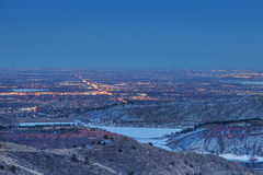 Fort Collins nightscape. Night view of Fort Collins in Colorado with foothills and Horsetooth Reservoir, winter scenery Stock Image