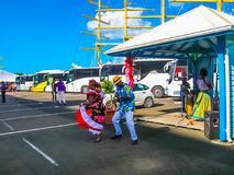 Fort-de-France, Martinique, France - February 08, 2013: Street entertainers. With tourists at port in Point-a-Pitre, Guadeloupe on February 09, 2013 in the stock photos