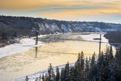 Fort Edmonton Footbridge. In winter season with river in floating ice royalty free stock photos