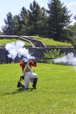 Soldier fires the musket Stock Images