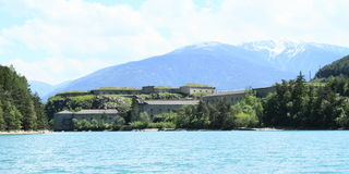 Fort Festung Fortezza Franzensfeste. In Franzensfeste on the bank of lake Lago Fortezza Stausee Franzensfeste in Alps (Italy Stock Photography
