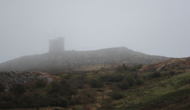 Fort on foggy hillside Stock Image