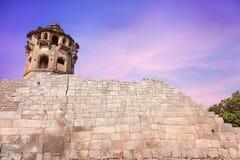 Fort in Hampi. Ancient watch tower and brick wall at royal center in Hampi, Karnataka, India royalty free stock image