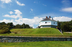 Fort on the Hill. A fort building on a green grass hill stock image