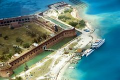 FORT JEFFERSON AERIAL. Fort Jefferson National Park Aerial view of boating dock and old dock ruins with two tourit passenger boats at dock stock image