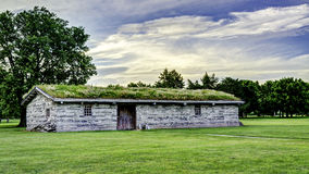 Fort Kearney Nebraska main building with sod roof royalty free stock images