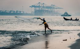 Fort Kochi fisherman throwing his net into stock images