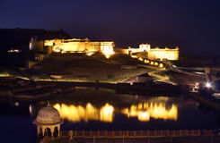 Fort and lake in Jaipur India at night Royalty Free Stock Images