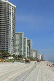 Fort Lauderdale Beach Restoration. Fort Lauderdale, FL, USA - March 3, 2016: Dump trucks with sand leave beach tracks in beach restoration. Dump trucks with sand Royalty Free Stock Photo