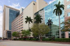 Broward County Courthouses. FORT LAUDERDALE, FLORIDA, USA - MARCH 5, 2019: Street view of the old Broward County Courthouse in the foreground and the new taller royalty free stock images