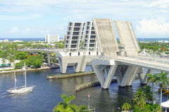 FORT LAUDERDALE, USA - JULY 11, 2017: Aerial view of an opened draw bridge raised to let ship pass through at harbor in stock images