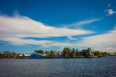 FORT LAUDERDALE, USA - JULY 11, 2017: Beautiful view of new river with riverwalk promenade highrise condominium. Buildings and yachts parked in the river, in Stock Photography