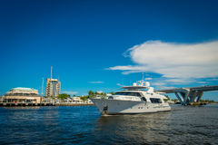 FORT LAUDERDALE, USA - JULY 11, 2017: Beautiful white yatch with a nice view behind of an opened draw bridge raised to. Let ship pass through at harbor in Fort Stock Photos