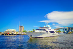 FORT LAUDERDALE, USA - JULY 11, 2017: Beautiful white yatch with a nice view behind of an opened draw bridge raised to. Let ship pass through at harbor in Fort Royalty Free Stock Images